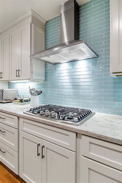 the reflective quality of this kitchen s blue glass tile