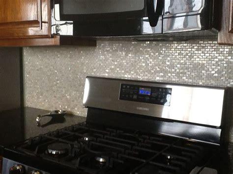 cream brick pearl shell tile kitchen backsplash subway