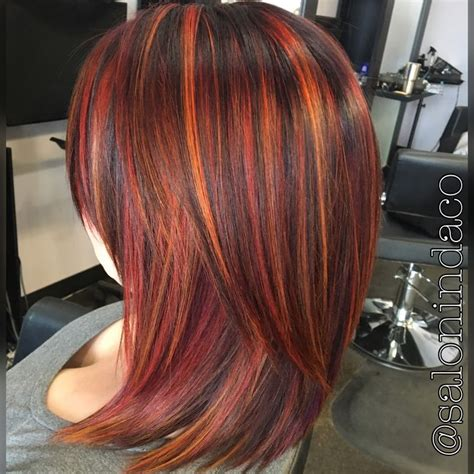 long bobs and highlights sunset balayage red hair color with blood orange