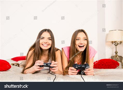 hot video in bedroom exited sexy girls playing video games stock photo 383963011 shutterstock