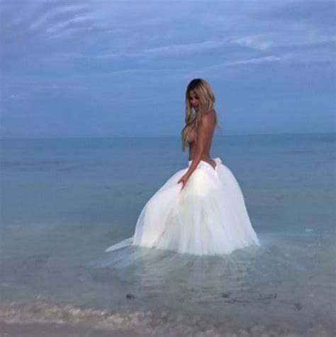 kim zolciak poses in wedding gown after renewing