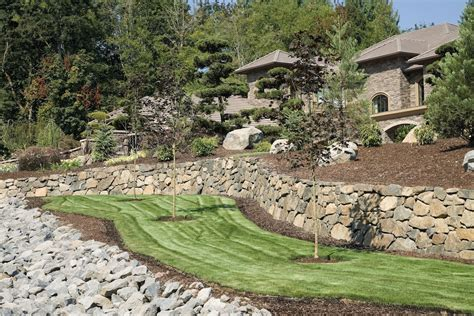 sloped backyard before and after 2017 landscape grading and resloping costs price to