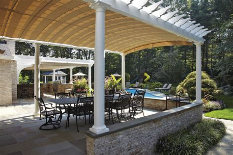 Pergola With Retractable Awning by Arched Retractable Awnings In Oyster Bay Shadefx Canopies