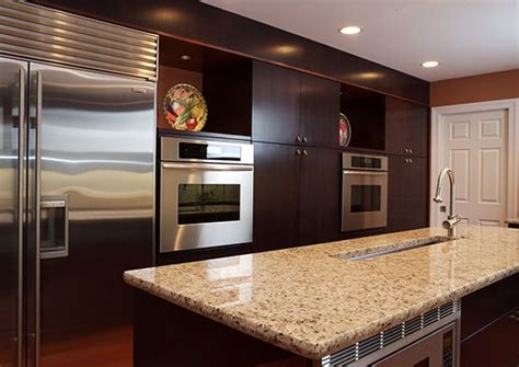modern kitchen with red accent backsplash and island decoist this modern kitchen space features walnut cabinets a