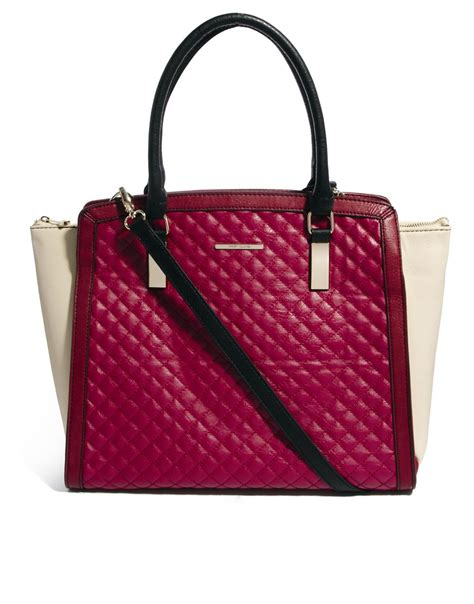 River Island Quilted Tote Bag by River Island Quilted Winged Color Block Tote Bag In Purple