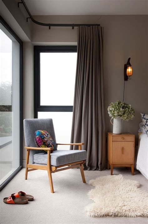 dark walls accents  orange panton  chairs vladimir