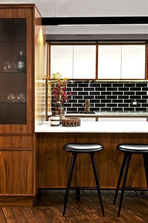 black subway tiles  modern kitchen design ideas