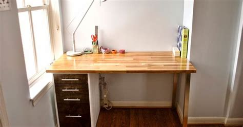ikea custom desk using the ikea alex drawer unit as legs and the hammarp counter top as a table we created a