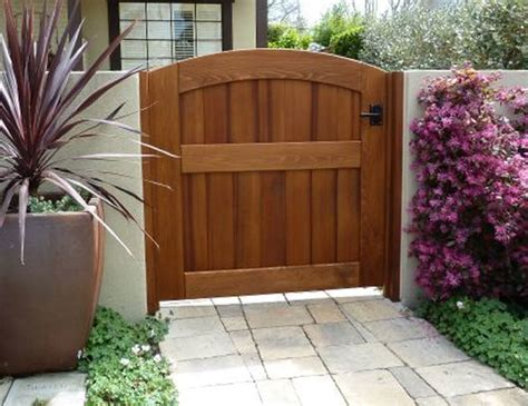 Garden Wooden Gate Archtop Attached To Stucco Wall Using Garden Walls And Gates