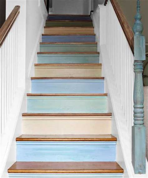 wooden stairs with painted stripes updating interior design in creative style