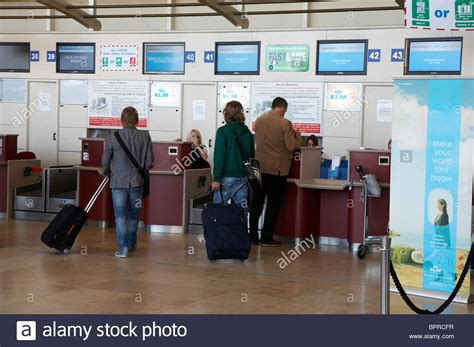 check in desk at john lennon liverpool airport stock photo