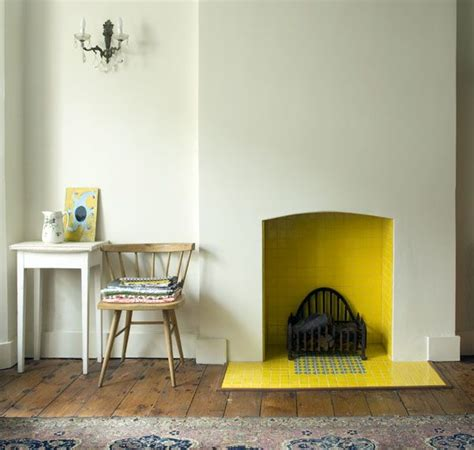 Yellow Fireplace | ask apartment apothecary what to do with an unused