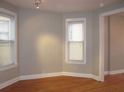 new apartment sneak peak living room dining room white trim woods and gray