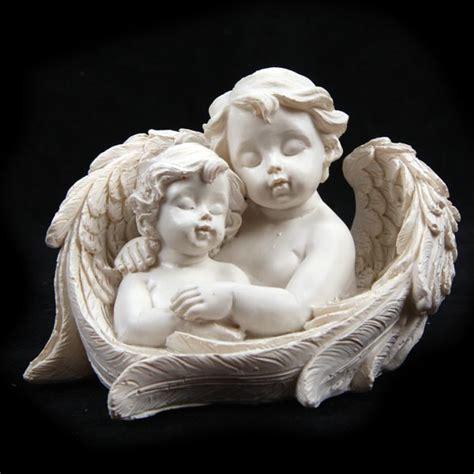 cherub and cherub child in wings ornament