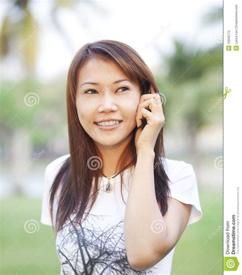 who is the asian girl in the mobile strike commercial asian girl calling with mobile phone stock photography