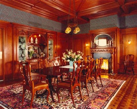 formal dining room with wood panel walls and detailed wood