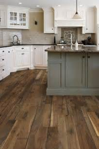 kitchen floors with white cabinets love the taupe subway tile white cabinets gray island and the wide wood plank floor future