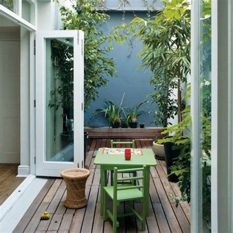 petit patio corridor decor maniac outdoor gardens backyards and masonry paint