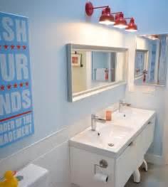 Sleek modern kids bathroom with interesting lighting choice