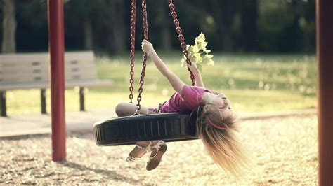 swinging with how the playground can help your child s development