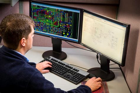 pcb layout engineer designing a pcb layout for effective board testing