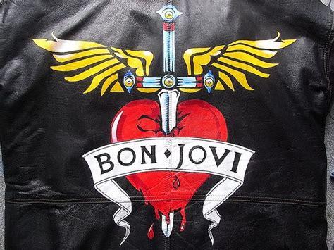 tattoo logo bon jovi bon jovi heart and winged dagger logo painted on a leather