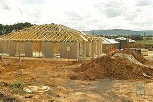 house building building construction site with wooden beams in house roof at gungahlin in canberra s