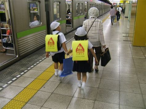 in japan small children take the subway and run errands mixed signals kid signs