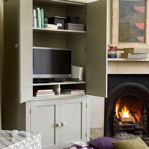 TV and storage cupboard in one   Small country living room
