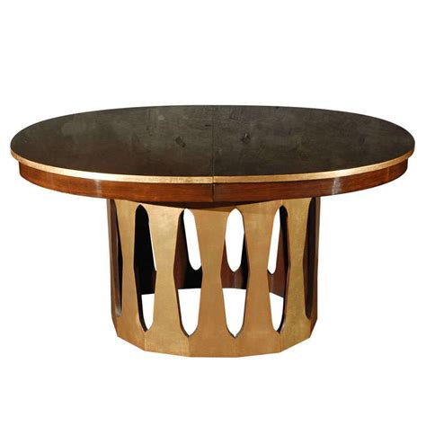 rosewood and gold leaf oval dining table by harvey probber