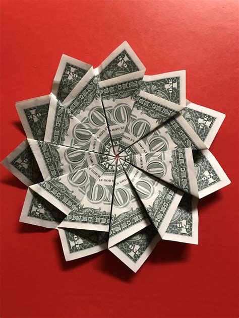 How To Make Money Origami Flower - 25 best ideas about money flowers on money