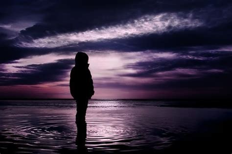 lonely girl at night alone clouds colorful colors dark earth image