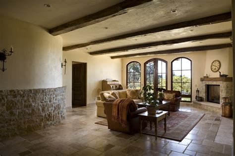 stone wall fireplace living room mediterranean with accent downstairs living room