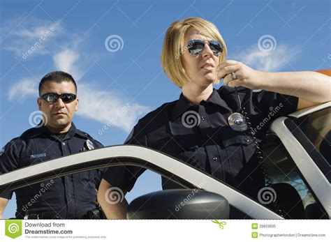Two Officers by Officers Using Two Way Radio Royalty Free Stock