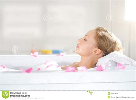 relaxing bathtub an attractive girl relaxing in bath stock photo image