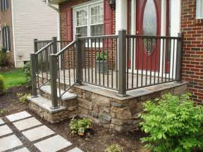 green front porch railing in a beautiful brick