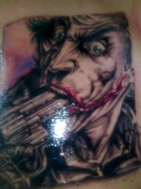 joker tattoo gun joker tattoo by nikcann on deviantart