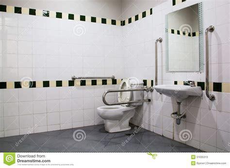 Handicap Bathroom With Grab Bars And Ceramic Tile Stock