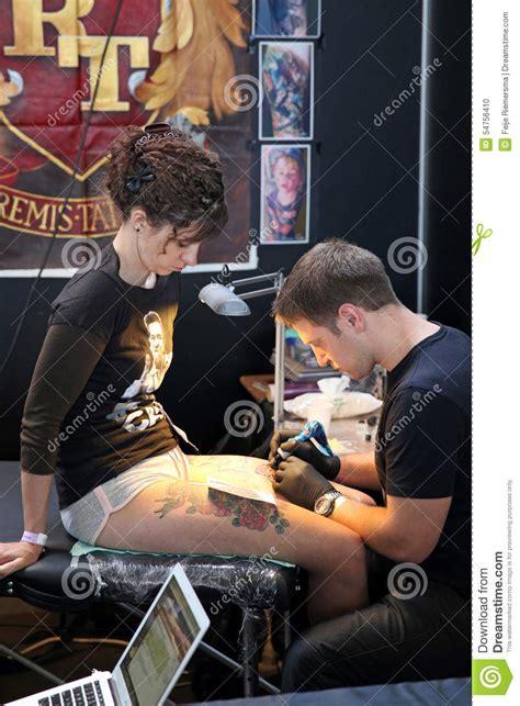 tattoo shop girl job girl getting a tattoo at a tattoo studio editorial image