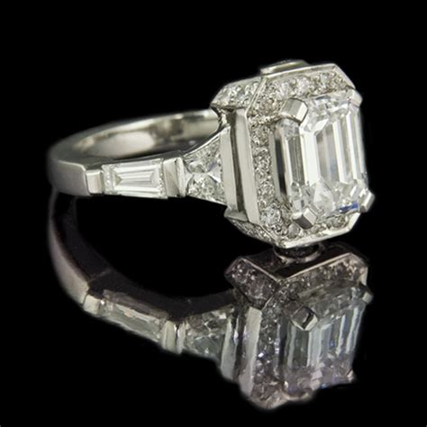 jeweller in emerald cut engagement ring