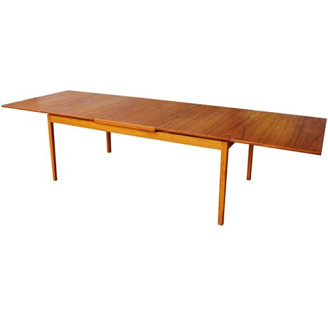 dining table leaves skaraborgs teak flip open leaf dining table nearly doubles in size at 1stdibs