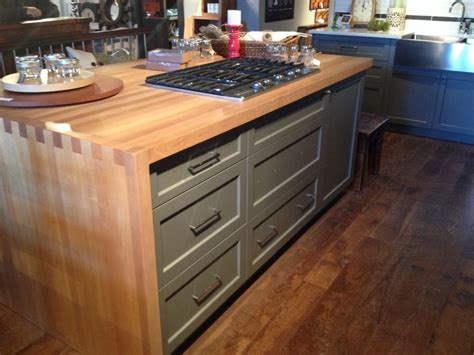 i want an island so ridiculously massive that a family of four love this butcher block waterfall counter on the island