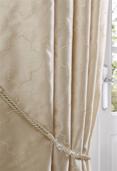 cream curtain nouveau cream lined eyelet curtains woodyatt curtains stock