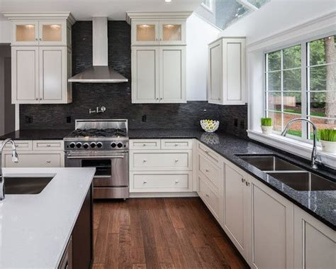 kitchens with white cabinets and black countertops white hanging cabinet finish patterned black granite