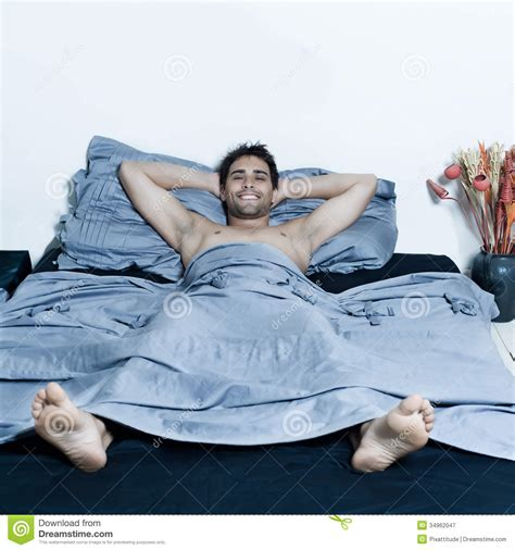 bed man handsome man in a bed royalty free stock photography