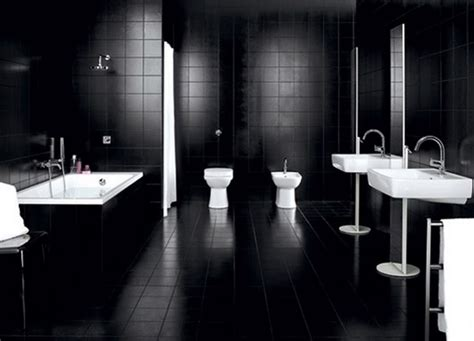 Lovely large bathroom with dark wall tiles white sinks and mirror with white tub and shower