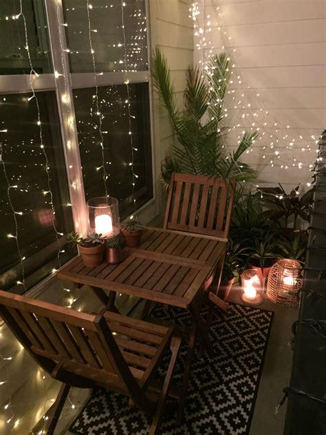 tiny outdoor string lights small balcony decor ideas small apartment balcony design