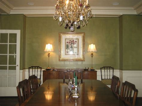 textured olive green adds drama to a classic dining room