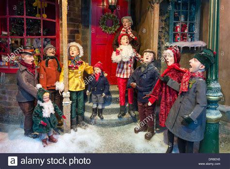 christmas house window displays fortnum mason christmas window display of carol singers outside a stock photo
