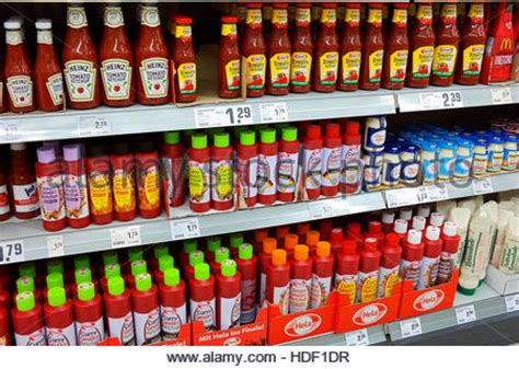 Shelf Of Ketchup by Shelf With Food In A Supermarket Ketchup And Other Sauces